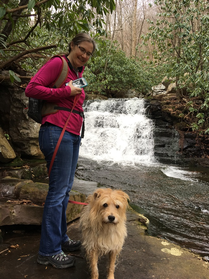 Sparky the dog and owner at waterfall in Mill Creek