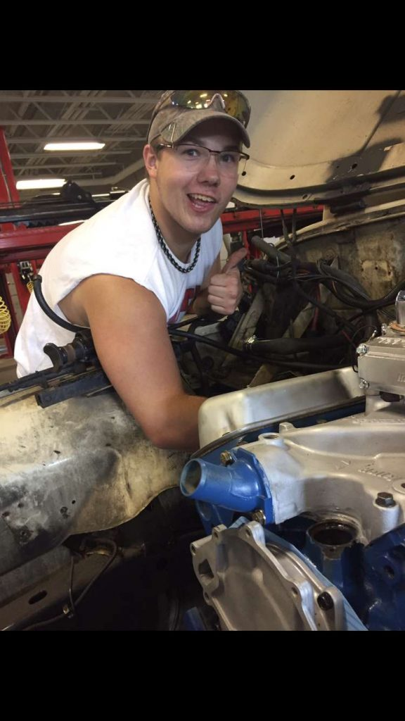 HUNTER TRENAR, CURRENT GILES ACCE STUDENT works on truck