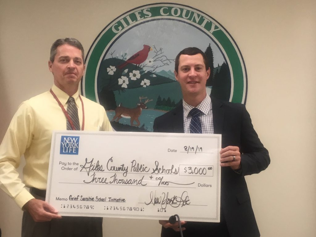 Andrew with Dr. Arbogast New York Life check presentation