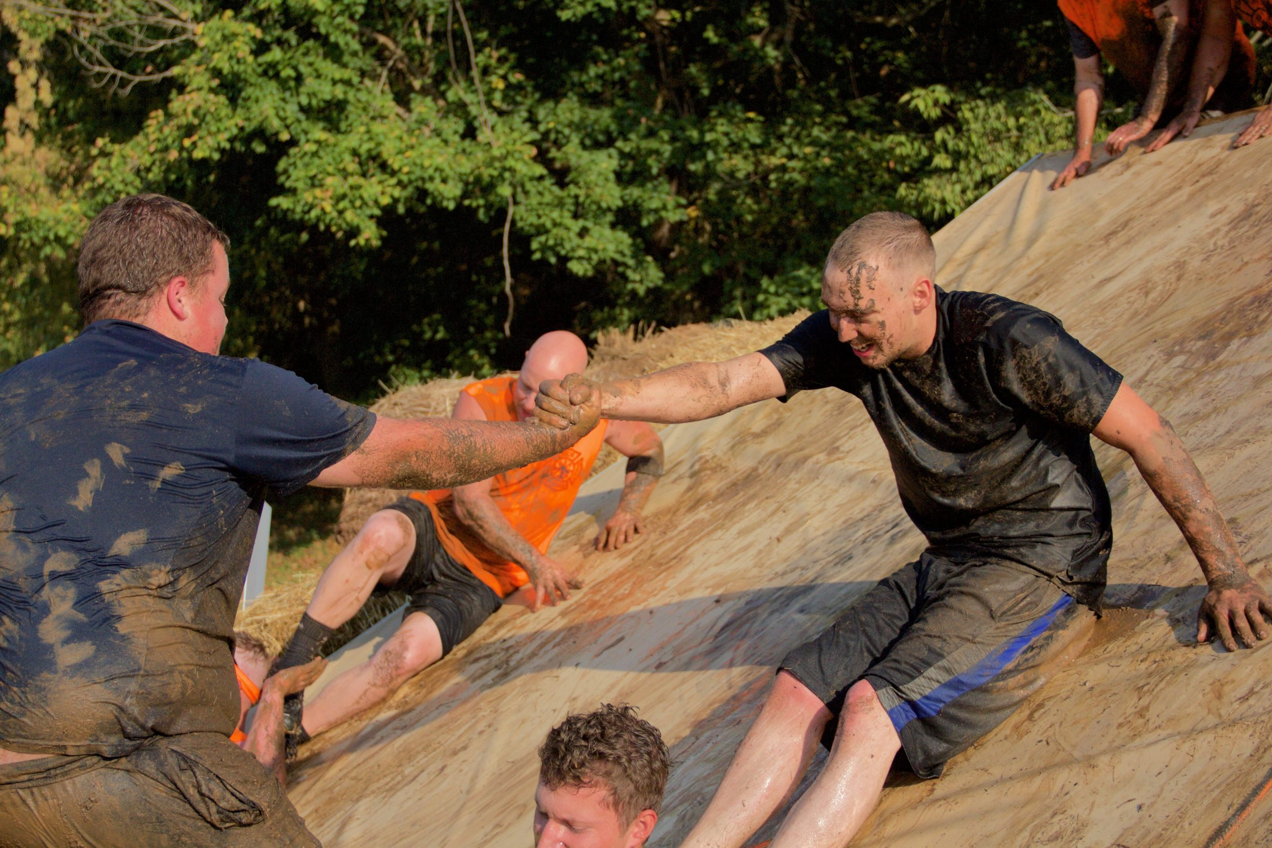 men in mud at Muddy ACCE Race
