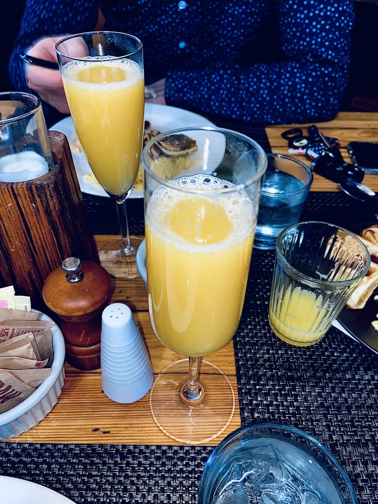 brunch foods and drinks on wooden table