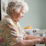 elder lady at sink washing hands