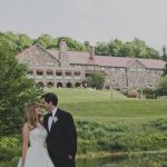 Bride and Groom in front of Mountain Lake Lodge in wedding attire